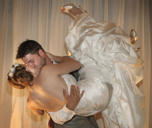 groom lifting his bride during the wedding's reception