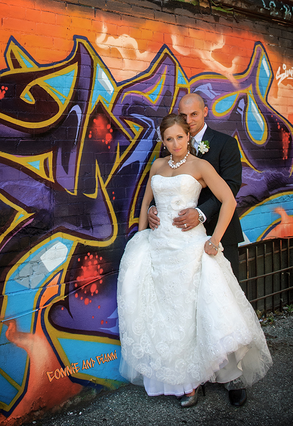 Couple in front of a Graffiti Alley mural